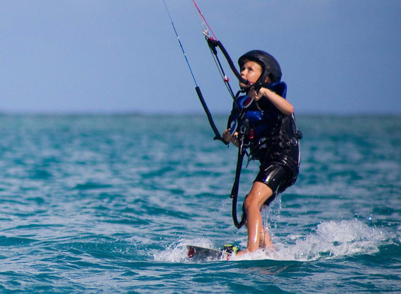 child learning kitesurfing in antigua at 40knots caribbean