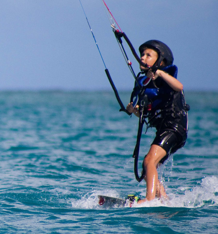 child learning kitesurfing in antigua at 40knots caribbean